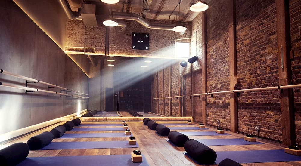 brick room with yoga mats