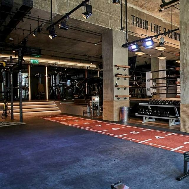 A crossfit area and a boxing ring