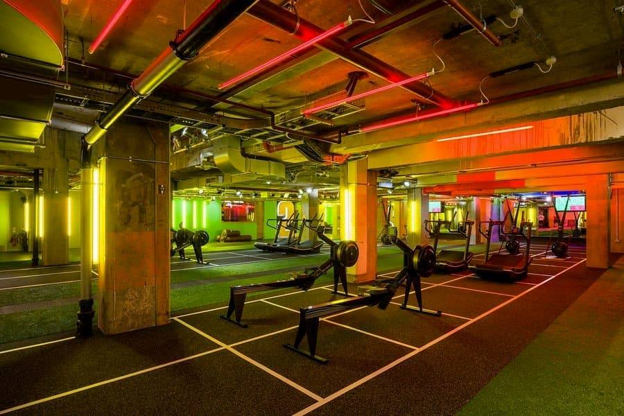 yellow and red lighted fitness room