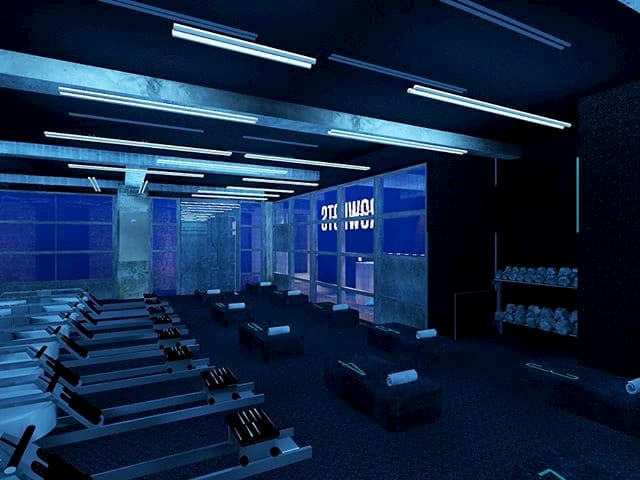 A dark room with rowing machines