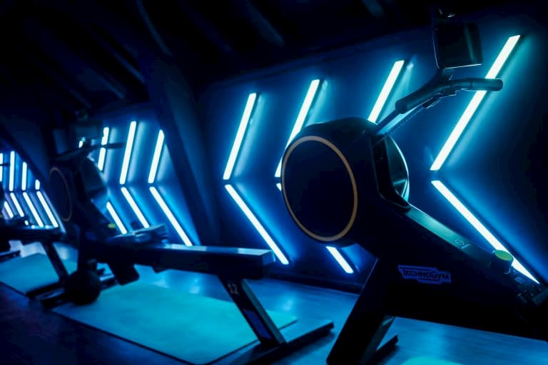 A futuristic fitness machine with blue lights