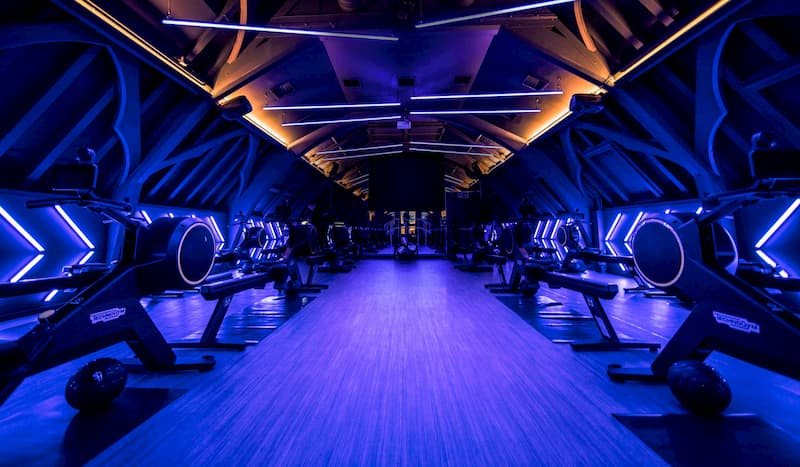 Futuristic room with fitness machines in it