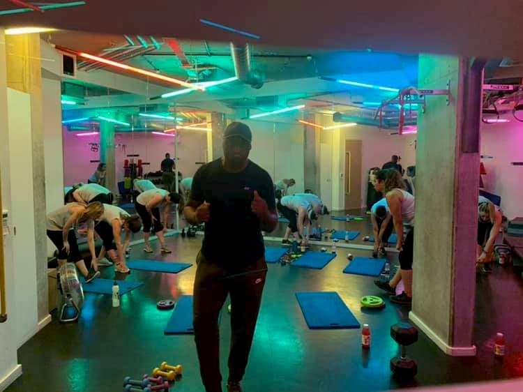 Room with rainbow colours and yoga mats
