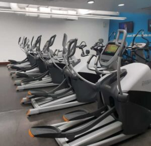 Spinning class with spotlights on the coach